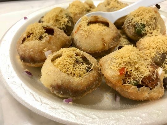 Pani puri filled with ragda and chutney from Tiku's
