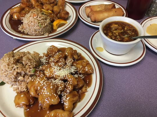 Sesame chicken (front) and orange chicken (back) are $6.98 each, served with rice and soup, at Sam's Fine Food and Egg Rolls.