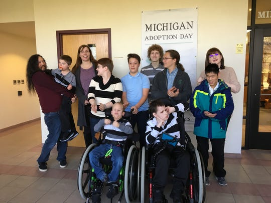 One big happy family: In back from left are Bob Broadbent, Andrew Broadbent (adopted Nov. 21), Jennifer Broadbent, and Ezra Patrick. In center row are. Zella Patrick, Ben Broadbent, Nick Broadbent and McKenna Patrick, with Elijah (Robbie) Broadbent, adopted Nov. 21, Christopher Chesler, and Parker Broadbent.