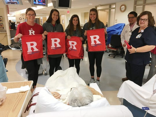 Student-Athletes from the Rutgers Women's Lacrosse team (Regina Sharp, Paige Paratore, Brianna Cirino and Amanda Casten) visit with patients receiving outpatient infusion at the J. Phillip Citta Regional Cancer Center at RWJBarnabas Health's Community Medical Center.