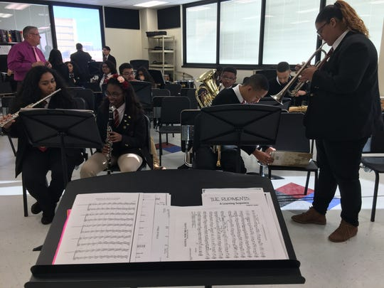 Student musicians at Camden Academy Charter High School tune their instruments during rehearsal. The small group is part of an All-Star Marching Band performing in the Philadelphia Thanksgiving Day Parade Nov. 23, 2017.