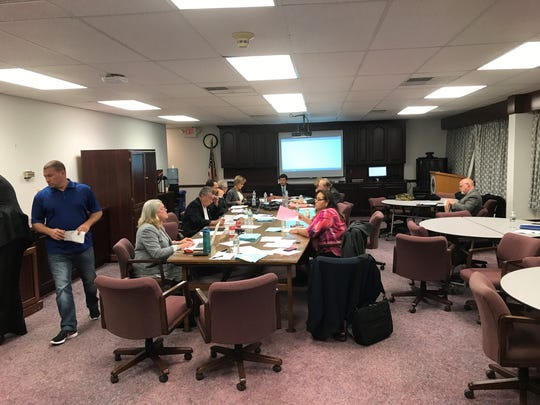 The Toms River Board of Education takes a break after meeting for 90 minutes in executive session on Nov. 15, to discuss the final terms of Superintendent David M. Healy's new five-year contract.