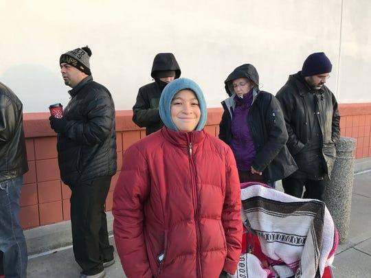 Dakota Tseng, 12, awaited Best Buy's 8 a.m. Black Friday