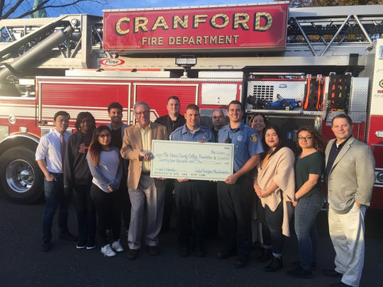 Cranford firefighters were joined by Union students for the check presentation