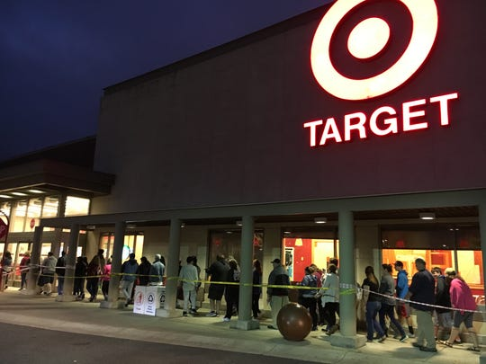 Shoppers line up outside Target, waiting for the store to open Thursday.