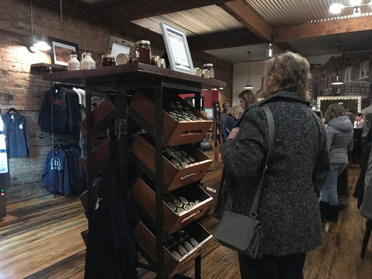 Shoppers look through local items available at Local