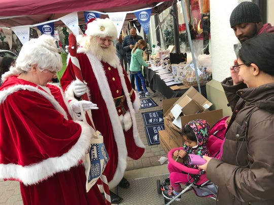 Santa and Mrs. Claus visit with shoppers during Small Business Saturday events in 2016 in Montclair.