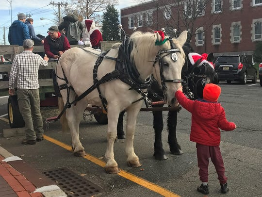 Two percheron horses took shoppers for a spin around