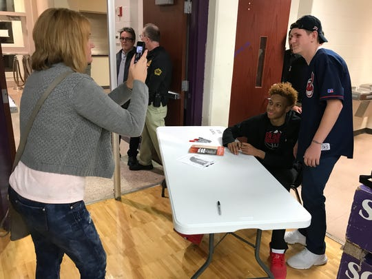 Romeo Langford poses for a photo and signs autographs