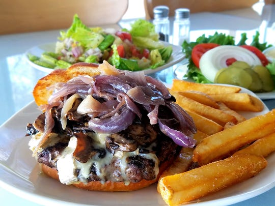 hef Graham Sheldon's passion is good quality, down-to-earth food. He loves to come up with burger specials such as this brie, mushroom and caramelized onion burger.