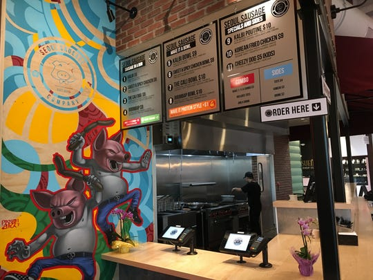 At Seoul Sausage inside The Annex in Oxnard, orders for bibimbap, Korean fried chicken and kalbi poutine are placed by patrons using tablets equipped with PIN pads.