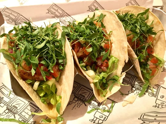 The shrimp tacos ($15) are filled with blackened shrimp,