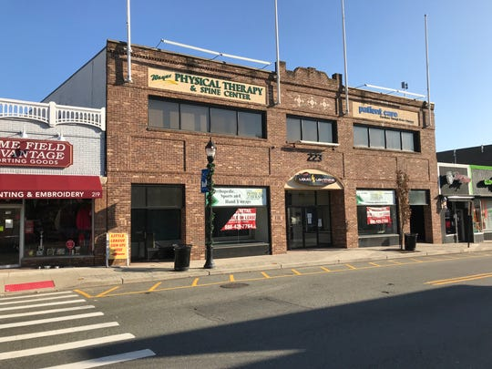 The front of the Town Center building at 223 Wanaque Avenue in downtown Pompton Lakes. Officials approved plans to convert the mostly vacant retail space into mixed use retail and residential and add two floors for a total of 20 apartment units.