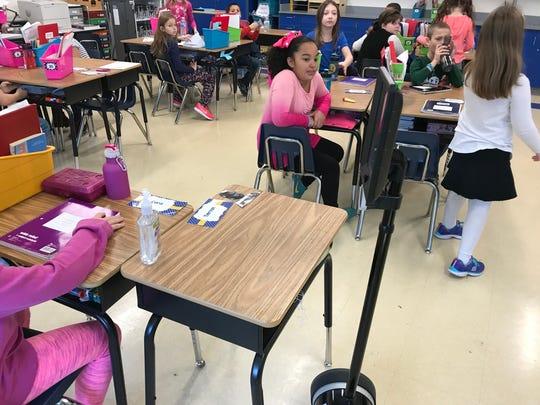 Tiernan Kriner, 8, parks his telepresence robot at his desk at Maine Memorial Elementary.