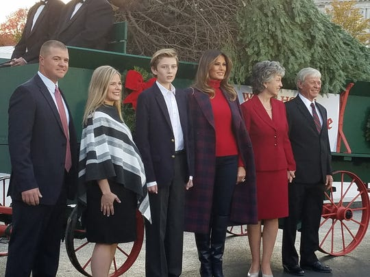 From left, David Chapman, Leah Chapman, Barron Trump,