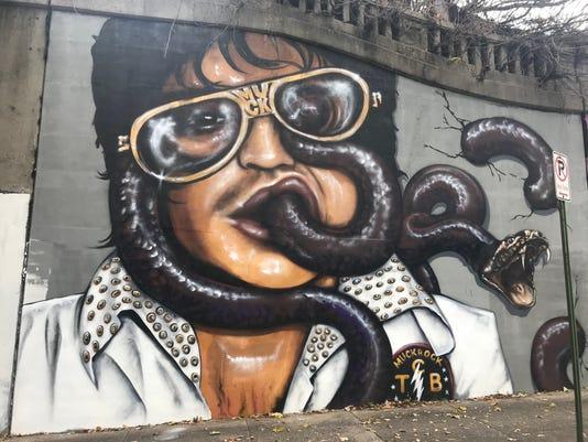 Elvis-snake mural raises concerns