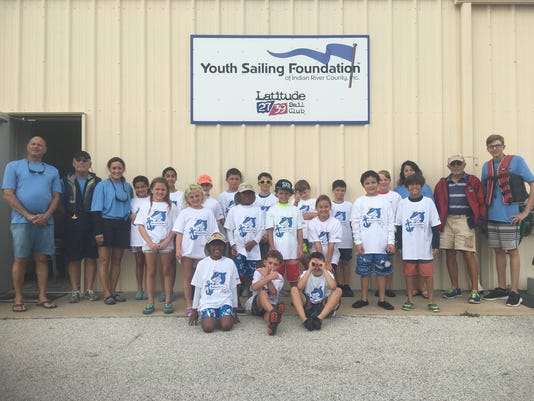 636475691734184905-YSF-Shark-Shirts-w-staff.JPG