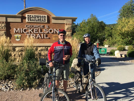 Craig Tieszen, left, and Brent Moline, right, pose for a photo before riding the George S. Mickelson Trail.