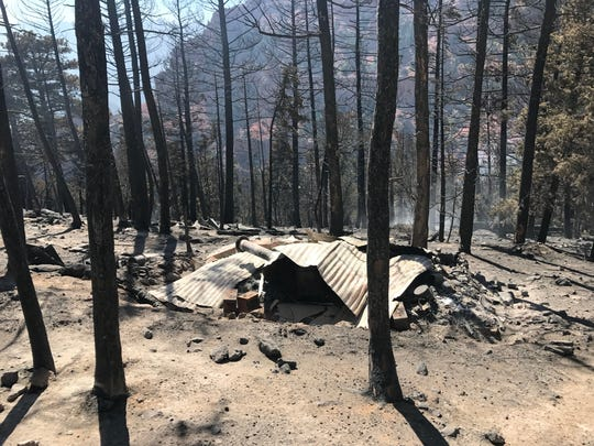 The remains of a cabin burned down by the Brian Head