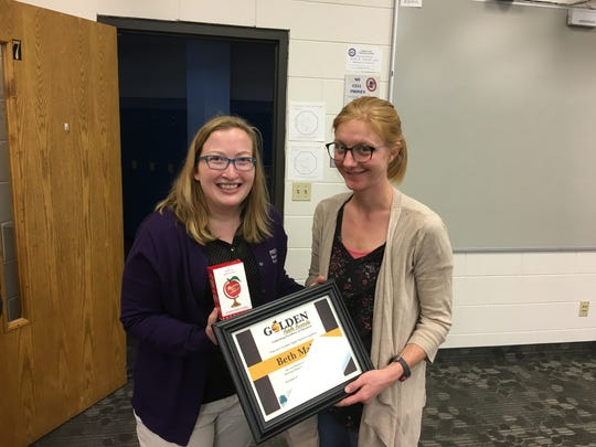 Beth Malik, right, of Stevens Point Christian Academy, poses with her 2017 Golden Apple Award for Excellence in Education.