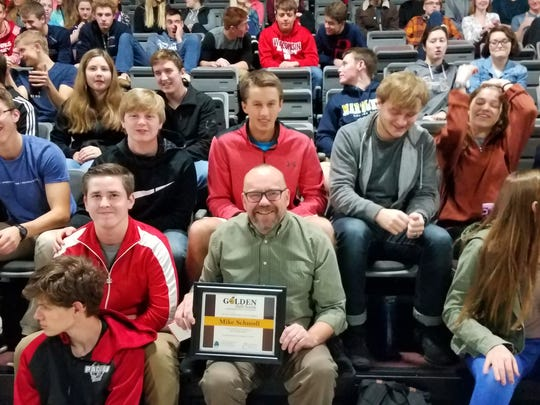 Mike Schmoll, of Pacelli High School, poses with his 2017 Golden Apple Award for Excellence in Education.