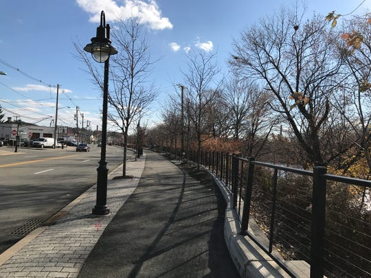 The city is preparing for future phases of RiverFront Park along River Drive by taking steps to buy two vacant properties.