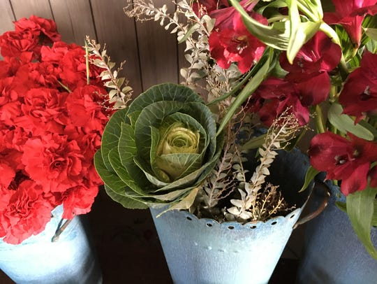 Fresh-cut flowers, even some kale, are offered at the