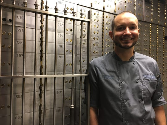 Vintage Year executive chef Eric Rivera stands in a bank vault that's being converted to a quiet room at the new Vintage Cafe.