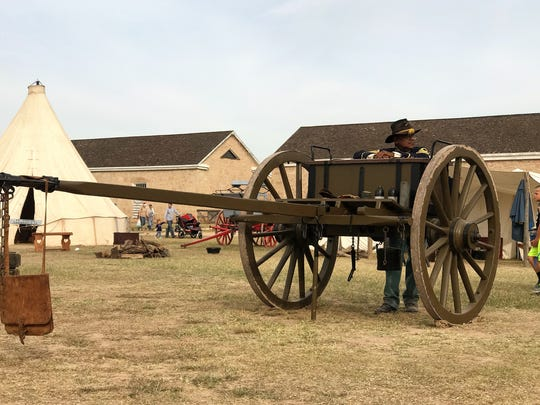 Richard Brown leans on a limber chest as re-enactors gather minutes before 3 p.m. Saturday, Dec. 2, 2017, at Fort Concho National Historic Landmark to fire cannons. The artillery demonstration is part of the annual Christmas at Old Fort Concho, a three-day event filled with living history, period displays and entertainment, shopping, food and more.