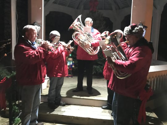 An ensemble of the Royal Oak Salvation Army band performs holiday tunes at the Gov. Warner Mansion.