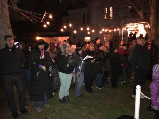 The Farmington Hills Community Choir leads the crowd