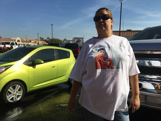 Annette Miranda, 44, wears a T-shirt with a picture