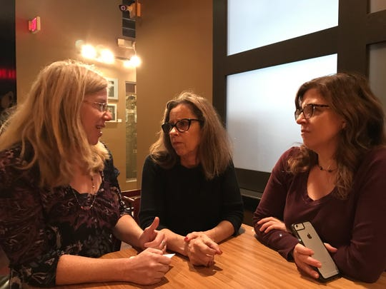 Amy Cantrell, Teri Siegel and Flori Pate organized the awards ceremony for homeless people part of the BeLoved community.