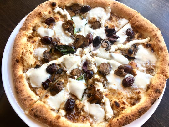 The truffle and vegetable pizza ($13.50) includes truffle