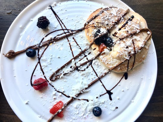 A Nutella calzone ($5.95) is made with Neapolitan dough and stuffed with Nutella and berries, topped with a balsamic glaze and shredded coconut.