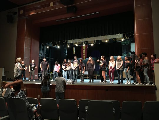 """Students rehearse """"Scrooge: The Musical,"""" which is"""