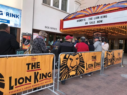 """About 50 people lined up early Monday morning outside of the Plaza Theatre to be among the first to purchase tickets to see Disney's """"The Lion King"""" musical."""