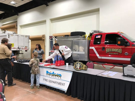 A fire engine attracted a young visitor to Ruidoso's