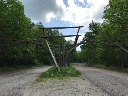 The archway at the entrance to the closed Jungle Habitat theme park in West Milford, as seen in May 2017, was torn down by state workers on Monday.