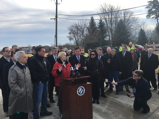 Candice Miller is joined by elected officials from around Macomb County, including from left, County Treasurer Larry Rocca, County Executive Mark Hackel and (right of Miller) Clinton Township Supervisor Bob Cannon, at the announcement that 15 Mile Road is now open to traffic between Hayes and Utica roads.