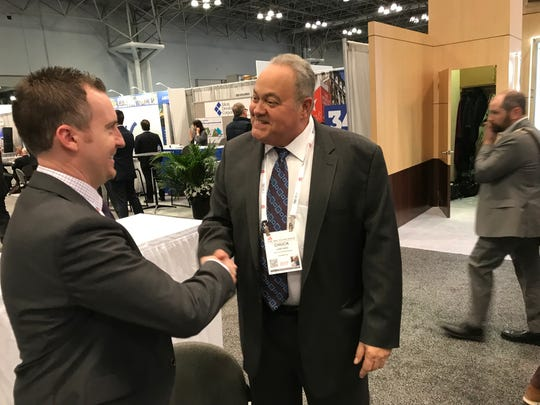 Chuck Lanyard, president of The Goldstein Group in Paramus, talking to Jason Samreny, a retail development consultant from Florida.