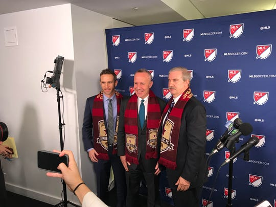 Members of the delegation for Sacramento Republic FC pose for a photo opportunity following a media session and final presentation to Major League Soccer for expansion into the league.