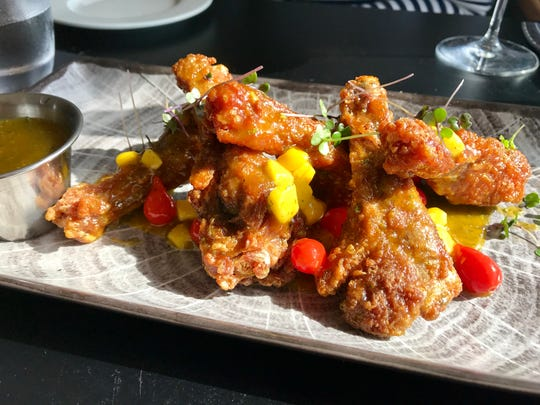 Duck wings in a citrus-chipotle glaze with mango and