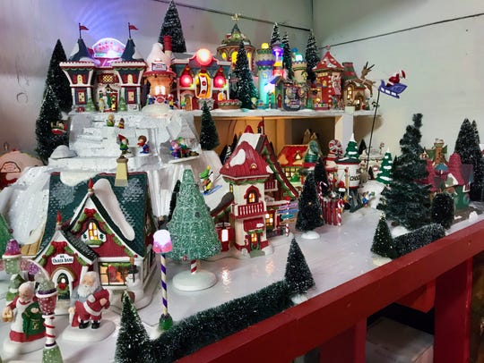 A Christmas village is displayed at Olives Nursery,