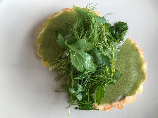 This chicken liver and green apple tart is the sleeper at Crispy Bird,  a stylish, new comfort food restaurant at 115 E. 49th St., Indianapolis. Subtle apple sweetness and fresh herb salad temper rich pate filling. Opening day was Dec. 7, 2017.