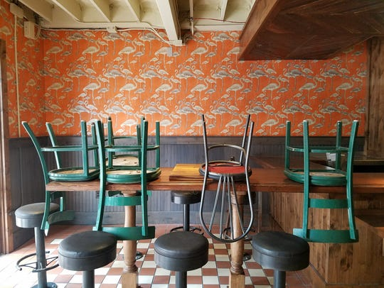 Downtown Deli Tavern features fun flamingo wallpaper,