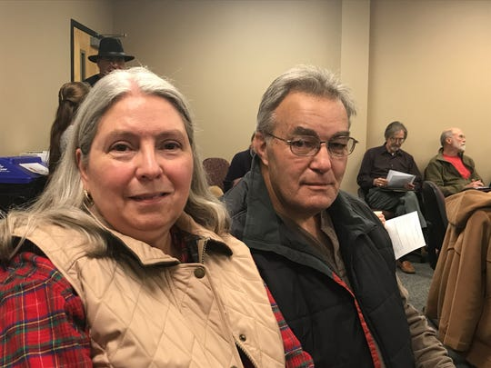 Janie and Ansol Clark sit in the back row at a public hearing on TVA's discharge permit.