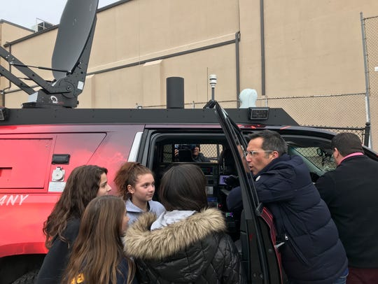 WNBC's Dave Price gives the students of Roosevelt School in Lyndhurst a tour of the Storm Chaser vehicle.