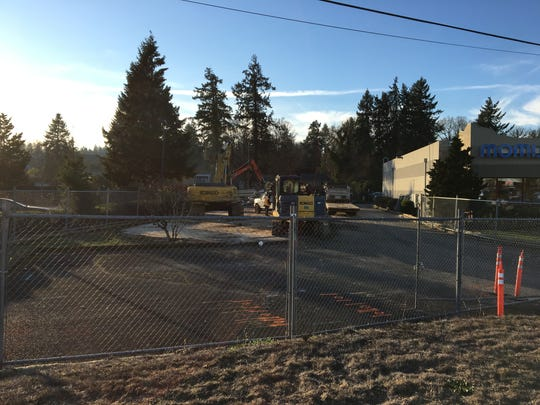 Construction work at 3415 Commercial St. SE in Salem, Oregon, on Dec. 8, 2017. The site is being demolished to make way for a Fred Meyer fueling station.