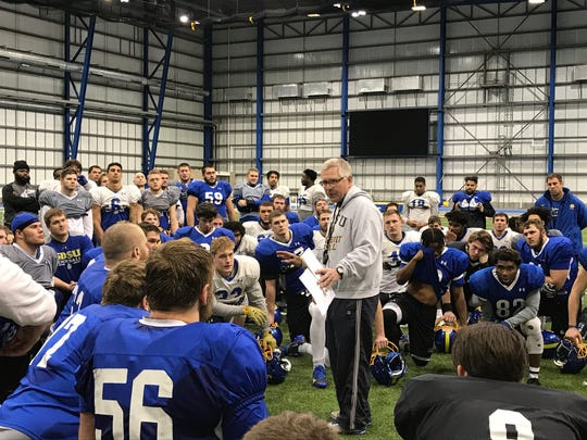 SDSU coach John Stiegelmeier addresses his team at the end of a practice this week at the SJAC in Brookings.
